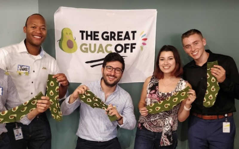 The winning team with their avocado prizes after a corporate team building event.